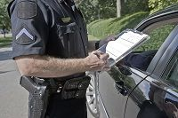 Officer writing ticket for DUI and drugs